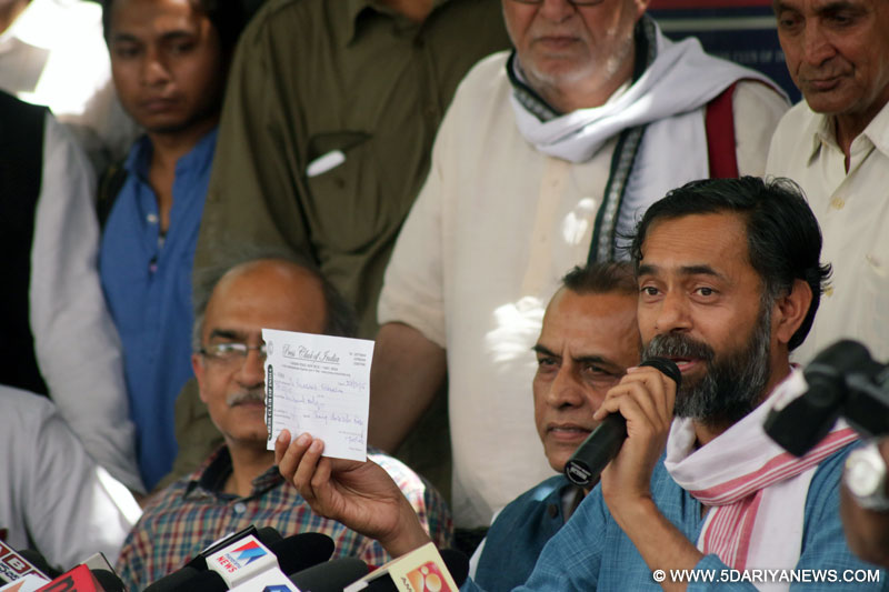 AAP leaders Prashant Bhushan and Yogendra Yadav address a press conference at the Press Club of India in New Delhi, on March 27, 2015.
