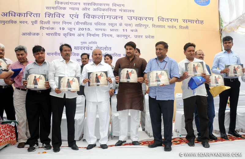 Thaawar Chand Gehlot releasing the TLM's Compendium, published by the Leprosy Mission Trust India, at the Samajik Adhikarita Shivir and distribution of aids and assistive devices to the leprosy cured persons with disabilities, in Delhi on June 19, 2015.