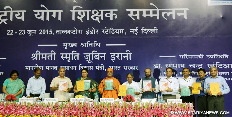 The Union Minister for Human Resource Development, Smriti Irani addressing at the inauguration of the Rashtriya Yoga Shikshak Sammelan, in New Delhi on June 22, 2015. The Deputy Chief Minister, Delhi, Shri Manish Sisodia, the Secretary, School Education and Literacy, Dr. Subash Chandra Khuntia and other dignitaries are also seen.