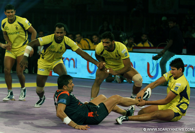 Kolkata: Players in action during Pro-Kabaddi League match between Bengal Warriors and Telugu Titans in Kolkata on July 23, 2015.