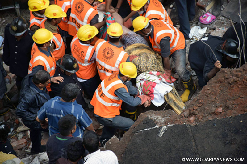Thane: Fire brigade and NDRF personnel carry out rescue operation at the site where a three-storey building collapsed in Thane, Maharashtra, on Aug 4, 2015. Atleast 11 persons died and five people have been rescued, six more are feared trapped under the debris.