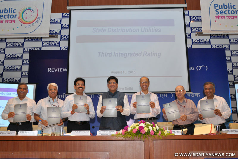 "Piyush Goyal releasing the book ""State Distribution Utilities Third Annual Integrated Rating"", in New Delhi on August 10, 2015. The Secretary, Ministry of Power, Shri P.K. Pujari and other dignitaries are also seen."