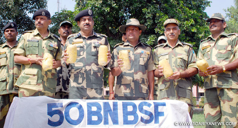 Border Security Force (BSF) Deputy Inspector General (DIG), M F Farooqui and others display before press heroin worth Rs 30 crores in international market, that was seized near Amritsar on Sep 6, 2015.