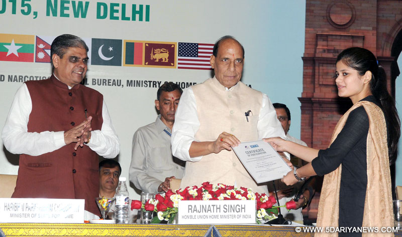 The Union Home Minister, Shri Rajnath Singh distributing the certificate to a youth representative at the inauguration of a three-day workshop on Sub-Regional Drug 'Focal Point Meeting and DDR Expert Group Consultation, South Asia under Colombo Plan Drug Advisory Programme', in New Delhi on September 09, 2015. The Minister of State for Home Affairs, Shri Haribhai Parthibhai Chaudhary is also seen.