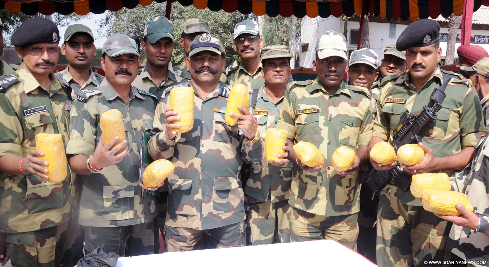 Amritsar: BSF soldiers present before press 14 kg heroin valued at Rs 70 crore in the international market that was recovered near Border Out Post Chanmulla about 40 Km from Amritsar, on Oct 17, 2015.