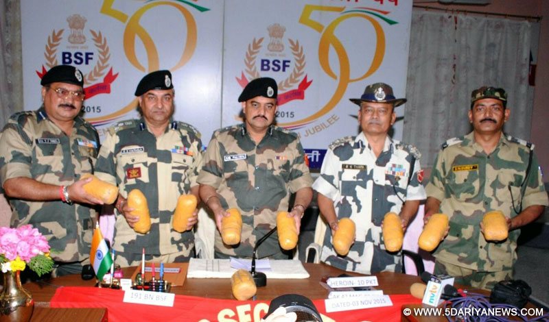 BSF personnel present before press 10 kg heroin -valued at Rs.50 crore- recovered by them in Ferozepur of Punjab on Nov 3, 2015.