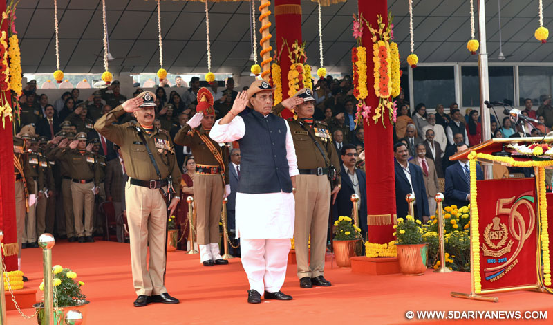 The Union Home Minister, Rajnath Singh taking the salute of the BSF Golden Jubilee Parade, in New Delhi on December 01, 2015. The DG, BSF, Shri D.K. Pathak is also seen.