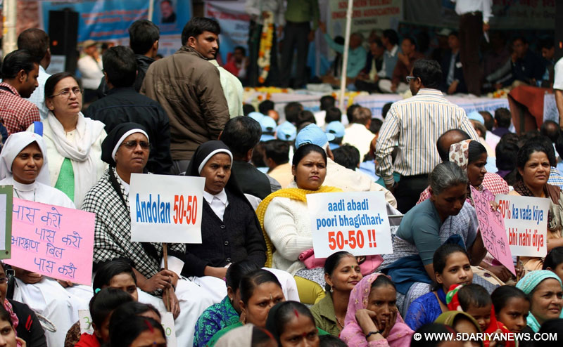Women stage a demonstration to press for passage of Women