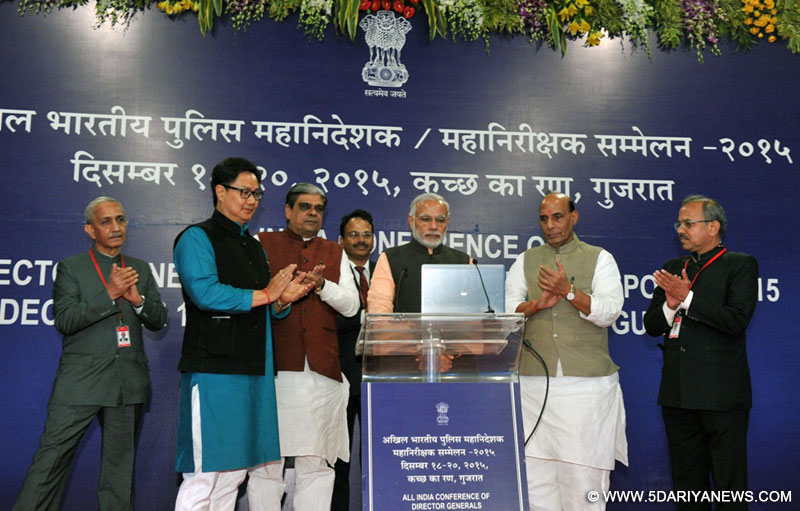 "The Prime Minister, Shri Narendra Modi launching a website – ""Indian Police in Service of the Nation"" at the inaugural session of three-day Conference of DGPs, in Gujarat on December 18, 2015.The Union Home Minister, Shri Rajnath Singh, the Minister of State for Home Affairs, Shri Kiren Rijiju and the Minister of State for Home Affairs, Shri Haribhai Parthibhai Chaudhary are also seen."