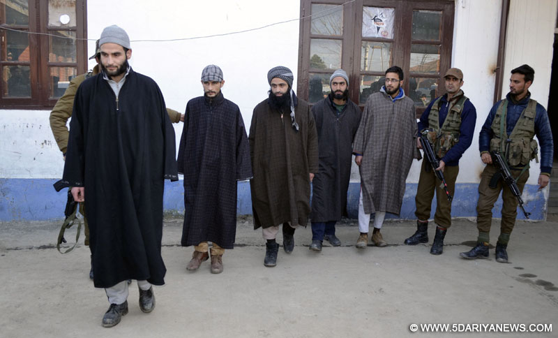Policemen present before press the five militants of Harkat-ul-Mujahideen at Sopore in Baramulla district of Jammu and Kashmir on Jan 23, 2016.