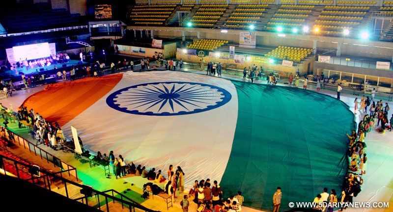 Bengaluru: The 33750 sq ft long Indian national flag which was stitched in 24 hours being displayed at Kanteerva Indoor Stadium, organised by VandeMathram Trust, in Bengaluru, on Jan 27, 2016.