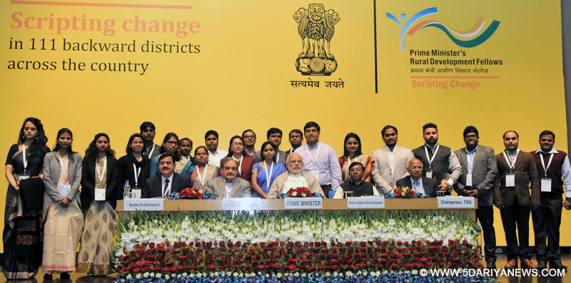 The Prime Minister, Shri Narendra Modi in a group photograph with the youth who have been working in rural areas under Prime Minister