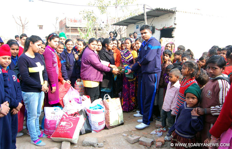 Ashmah International School distributed clothes in poor