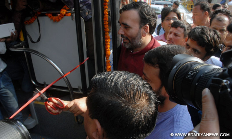 Delhi Transport Minister Gopal Rai flags off a pollution free electric bus that will run on trial basis for six months in Delhi on March 10, 2016.