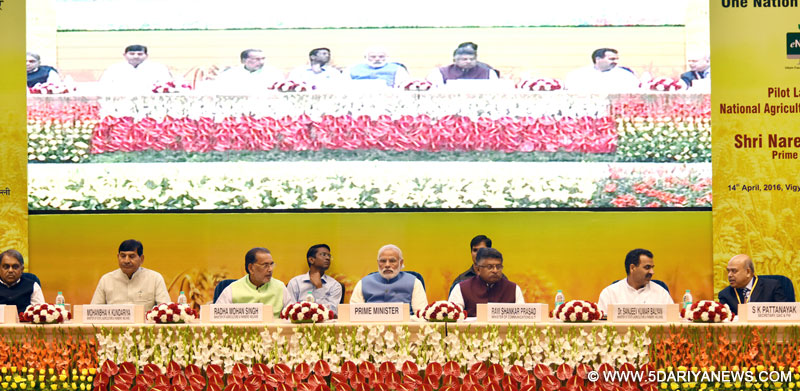 The Prime Minister, Shri Narendra Modi at the launching ceremony of e-NAM - the e-trading platform for the National Agriculture Market, in New Delhi on April 14, 2016. The Union Minister for Agriculture and Farmers Welfare, Shri Radha Mohan Singh, Union Minister for Communications & Information Technology, Shri Ravi Shankar Prasad, the Ministers of State for Agriculture and Farmers Welfare, Dr. Sanjeev Kumar Balyan and Shri Mohanbhai Kalyanjibhai Kundariya and other dignitaries are also seen.