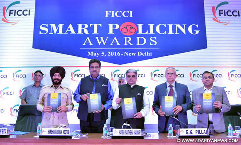 The Minister of State for Home Affairs, Shri Haribhai Parthibhai Chaudhary releasing a book on Smart Policing, at a function, organised by the FICCI on Smart Policing Awards, in New Delhi on May 05, 2016.