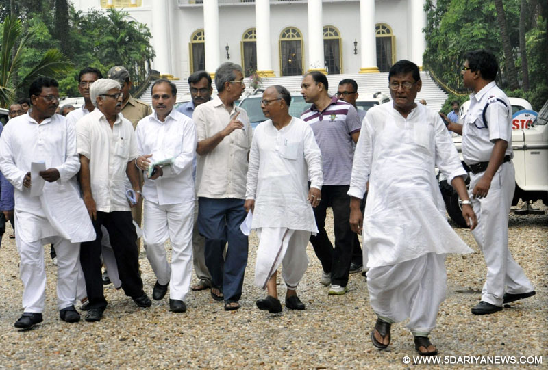CPI-M state secretary Surja Kanta Mishra, West Bengal Congress president Adhir Ranjan Chowdhury , other Congress and Left leaders come out after meeting with West Bengal Governor Keshari Nath Tripathi at Raj Bhawan in Kolkata, on May 23, 2016.