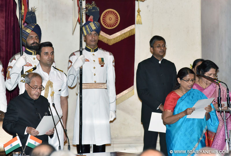 The President, Shri Pranab Mukherjee administering the oath as Minister of State to Smt. Krishna Raj, at a Swearing-in Ceremony, at Rashtrapati Bhavan, in New Delhi on July 05, 2016.