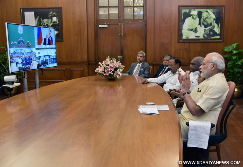 The Prime Minister, Shri Narendra Modi at dedication Kudankulam nuclear power plant unit-1 to the Nation with the President of Russian Federation, Mr. Vladimir Putin and the Chief Minister of Tamil Nadu, Ms. J. Jayalalithaa, through video conferencing, in New Delhi on August 10, 2016.