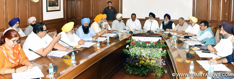 Punjab Chief Minister Mr. Parkash Singh Badal presiding over a meeting to review the arrangements for the commemoration of 350th Parkash Utsav of tenth master of Sikhs Sri Guru Gobind Singh ji at Punjab Bhawan, Chandigarh on Sunday.