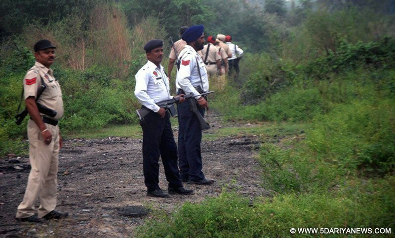 "Policemen carry out search operation following reports that some local residents had spotted 2-3 ""suspicious men"" in Army fatigues in Pathankot on Sept 27. 2016."