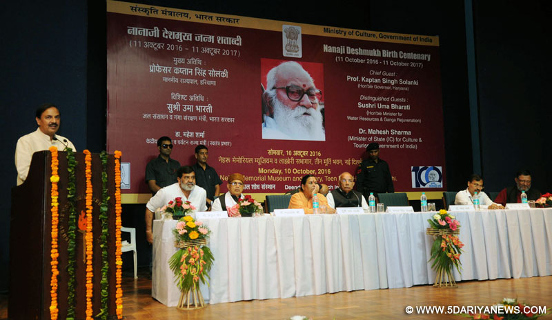 "The Minister of State for Culture and Tourism (Independent Charge), Dr. Mahesh Sharma addressing the ""Inaugural Function of Birth Centenary of Nanaji Deshmukh"", in New Delhi on October 10, 2016. The Governor of Haryana, Prof. Kaptan Singh Solanki, Uma Bharti, the Secretary, Ministry of Culture, Shri N.K. Sinha and other dignitaries are also seen."