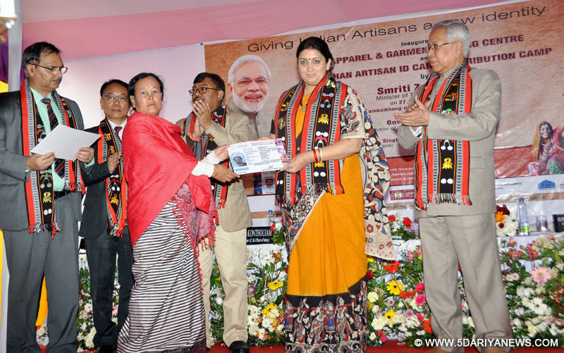 The Union Minister for Textiles, Smt. Smriti Irani distributing the 'Pehchan' Identity Cards to the artisan, at the inauguration of the Apparel and Garment Making Centre, in Imphal, Manipur on November 27, 2016.