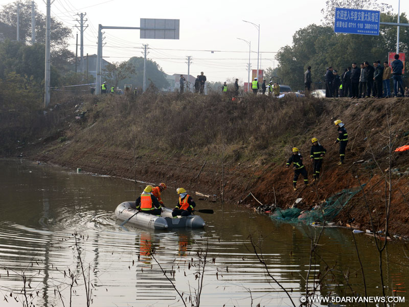 Rescuers work at the bus accident site in Miaoling Township of Ezhou City, central China