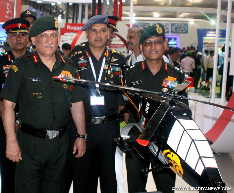 The Chief of Army Staff, General Bipin Rawat visiting the Army Aviation Pavilion, during the Aero India 2017, at Air Force Station, Yelahanka, in Bengaluru on February 14, 2017.