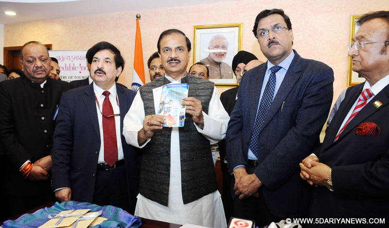The Minister of State for Culture and Tourism (Independent Charge), Dr. Mahesh Sharma launching the presentation of Pre-Loaded Free SIM Cards for foreign tourists arriving in India on e-visa, in New Delhi on February 15, 2017. The Tourism Secretary, Shri Vinod Zutshi and other dignitaries are also seen.