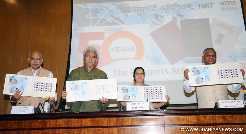 The Union Minister for External Affairs, Smt. Sushma Swaraj alongwith the Minister of State for Communications (Independent Charge) and Railways, Shri Manoj Sinha releasing the commemorative postage stamp to mark the completion of 50 years of the Passport Act, in New Delhi on June 23, 2017. The Ministers of State for External Affairs, General (Retd.) V.K. Singh and Shri M.J. Akbar are also seen.