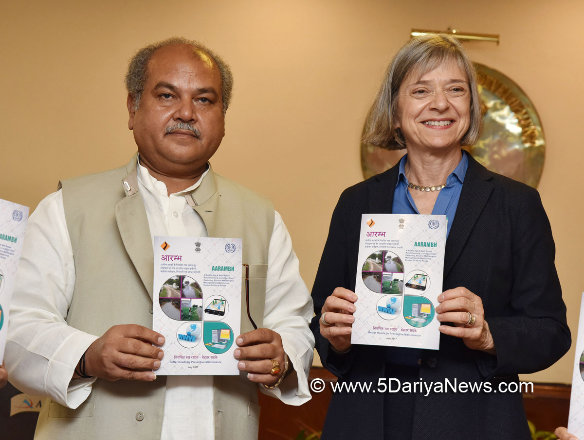 "Narendra Singh Tomar and the ILO Deputy Director General (Policy) International Labour Organization, Ms. Deborah Greenfield jointly launching the ""Mobile Phone based App for Performance Based Maintenance Contracting and Community Contracting for maintenance of rural roads"" brochure, in New Delhi on July 24, 2017."