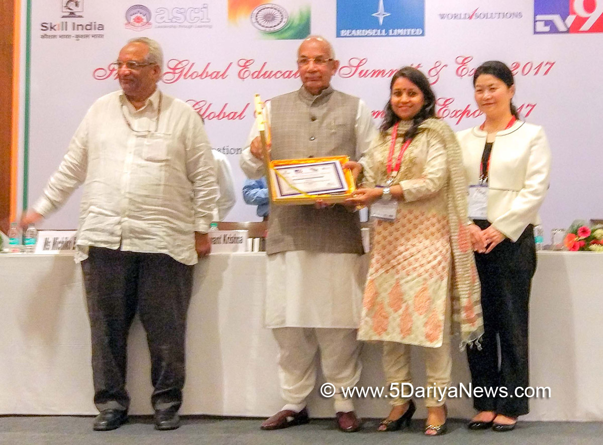 Principal UIET Swati Sharma receiving the award from Haryana Governor Kaptan Singh Solanki