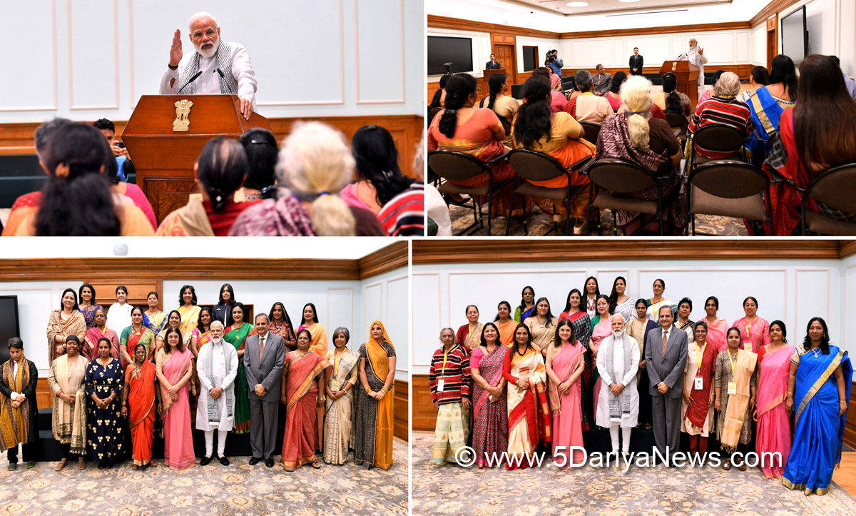 Narendra Modi interacts with recipients of Nari Shakti Puraskar