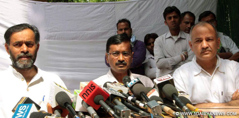 Aam Aadmi Party (AAP) leaders Yogendra Yadav, Arvind Kejriwal and Manish Sisodia address a press conference at Kejriwal`s residence in New Delhi on March 21, 2014.