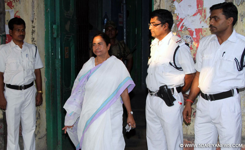 West Bengal Chief Minister Mamata Banerjee arrives to cast her vote at a polling booth during the ninth phase of 2014 Lok Sabha Polls in Kolkata on May   12, 2014.