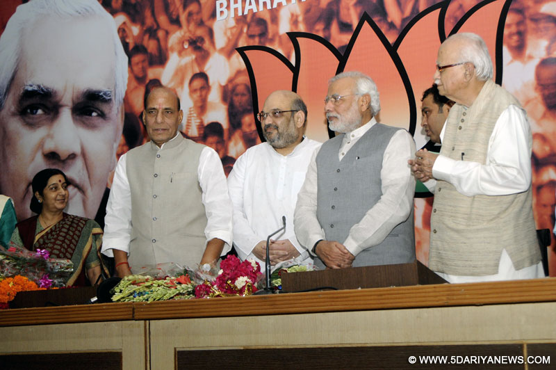 (L-R) External Affairs Minister Sushma Swaraj, Union Home Minister Rajnath Singh, new BJP chief Amit Shah, Prime Minister Narendra Modi, and BJP veteran L K Advani during a press conference organised to announce Shah