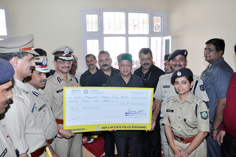 Chief Minister,  Virbhadra Singh being presented a cheque of Rs. 60 Lakh  by Director General of Police, Shri Sanjay Kumar towards CM Relief Fund at Nahan today.