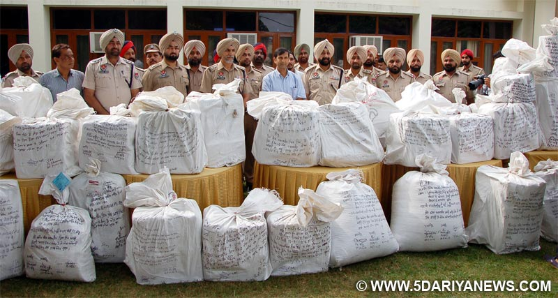 ADGP Law & Order Mr Dinkar Gupta Inspecting the huge Cache of Synthetic Drugs of   Rs 100 Crore Recovered by Patiala Police. SSP Patiala Mr Hardyal SinghMann & SP Rajpura Mr Bhupinder Singh Khatra are also seen in Picture